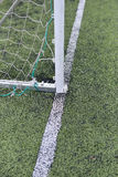 Detail of a used and scratched gate of football at a soccer field Royalty Free Stock Photo