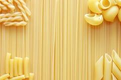 Detail van de deegwaren van de Macaroni nuttig als achtergrond Stock Foto's