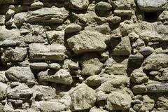 Detail van de oude muur van stenen in ruïnes stock afbeelding