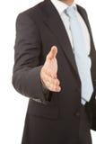 Detail van een bedrijfsmens met een open hand klaar om een overeenkomst te verzegelen Stock Fotografie