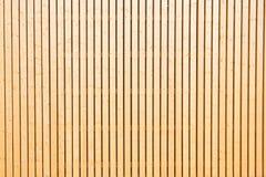 Detail van een houten muur op een zonnige dag Stock Afbeelding