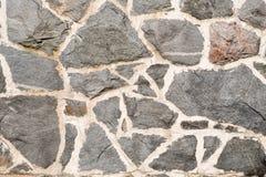 Detail van een muur van stukken van steen wordt gemaakt die stock foto's
