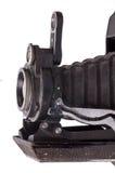 Detail van een oude camera op wit Stock Foto