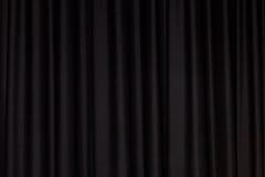 Zwart gordijn stock foto