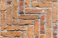 Detail van oude uitstekende muur in rood Stock Foto