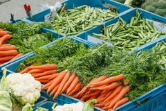 Detail of various vegetable items on farmer market. Photo shows detail view of various vegetable items on farmer market in plastic boxes during a day Stock Photos