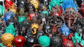 Detail of various wooden carved masks Stock Photo