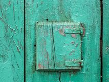 Detail of a very old weathered green door made of wood. Island Cres, Croatia stock photo