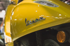 Detail of Vespa scooter on display at EICMA 2014 in Milan, Italy Royalty Free Stock Photos