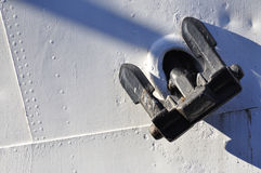 Anchor. Detail of a vessel, black anchor on white background Stock Photos