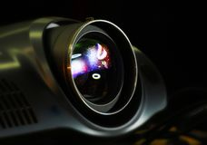 Hi tech Video Projector. Detail of a Video Projector playing in dark room stock photo