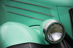 Detail view of antique car. Detail view of headlamp and fender of old car Royalty Free Stock Photo
