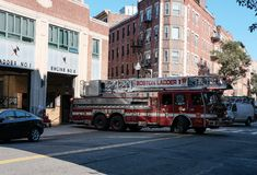 Boston Fire Department engine attend a call in the downtown area. Detail view of a Boston, MA fire truck seen moving away from its bay, attending an emergency royalty free stock image