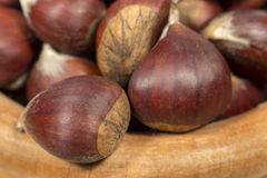 Detail view of chestnuts on a wooden bowl Stock Photo