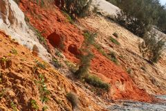 Detail view of the coloured sand cliffs at Rainbow Beach, Queensland, Australia stock photo