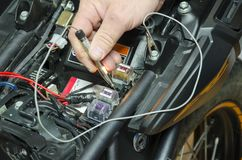 Detail view control voltage in motorcycle fuse box.  royalty free stock images
