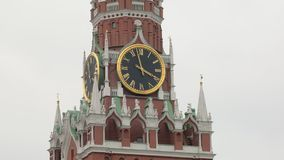 Detail view of famous clock on Spasskaya tower of Kremlin in Moscow, Russia, outdoors. Against cloudy sky stock video footage