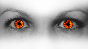 Detail view of female eyes with flames Royalty Free Stock Image