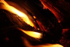 Detail view into fireplace ember wood.  Glowing embers. In hot red color Royalty Free Stock Photos