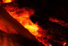 Detail view into fireplace ember wood.  Glowing embers. In hot red color Stock Photos