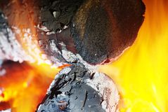 Detail view into fireplace ember wood.  Glowing embers. In hot red color Stock Photography