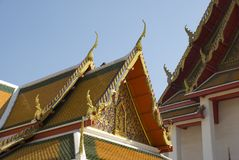 Golden ornate roof of buddhist temple in Bangkok, Thailand Royalty Free Stock Photography
