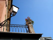Detail view of italian house with balcony and latern Stock Photo