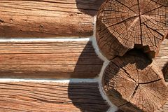 Detail of log built structure with chinking. Detail view of logs in log-built structure showing white chinking used to seal gaps between logs Royalty Free Stock Photo