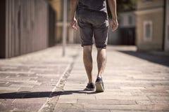 Detail view on man legs walk Stock Photos