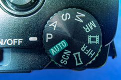Detail view of the menu selector wheel on a small black compact camera royalty free stock photos