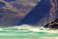 Detail view of mountains near Hout Bay, Cape Town, South Africa, seen from Noordhoek Long Beach. White sand beach and waves with spray. Noordhoek Beach is a Stock Images