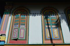 Detail view of multi coloured and patterned colonial windows and shutters on buffalo road Little India , Singapore Royalty Free Stock Image