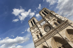 Detail view of Notre Dame Cathedral in Paris with dramatic blue sky Stock Photos