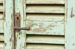 Vintage wooden front door of mediterranean house, close-up Stock Photography
