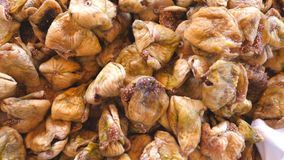 Detail view on pile of dried figs. Close up of falling sweet and tasty berries. Healthy food concept. Slow motion Top. View stock video