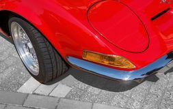 Detail view, from the right front corner of a red sports car with folding headlights, indicators,. bumper and a part of the front. Wheel, Germany royalty free stock images
