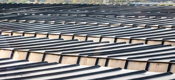 Detail view of a roof of a high-rise building with aluminium profiles as roof covering royalty free stock photo