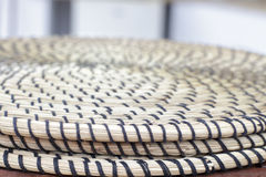 Detail view of several round trivet made of wicker Stock Photos