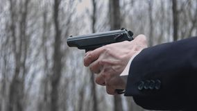 Detail view of shooter holding gun in hands, close up. Detail view of shooter holding gun in hands, close up stock video footage