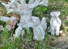 Small statue in garden. Detail view, small statue in garden royalty free stock photography