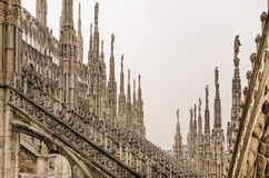 Detail view of stone sculptures on roofs of Duomo Milano Stock Photo