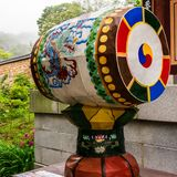 Detail view on a traditional drum, barrel in the Korean Buddhistic Temple Beomeosa on a foggy day. Located in Geumjeong, Busan, stock photography