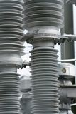 Detail view of transformers and conduits at an electric power station. A detail view of transformers and conduits at an electric power station royalty free stock photos