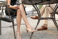 Business people legs in cafe with technology. Stock Image