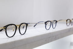 Detail view of various eyeglasses lying on a tray Royalty Free Stock Photo