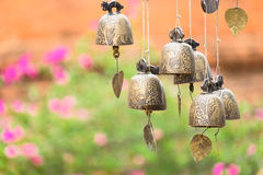 Detail view of vintage bronze bells with colorful bokeh Royalty Free Stock Photos