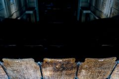 Detail of Wood and Cast Iron Seats - Abandoned Historic Theater, Pittsburgh, Pennsylvania. A detail view of wood and cast iron seats at an abandoned and historic Stock Images