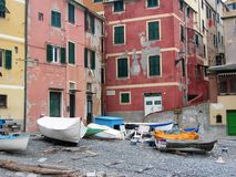 Detail of the village of Boccadasse an old mariners` neighbourhoodon with small boats on the beach, Liguria Italy. Colored houses. Damaged houses. Red, pink Stock Photos