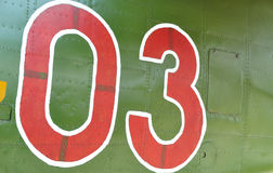 Detail vintage aircraft. Detail of a military aircraft with a label 03 on it Stock Image