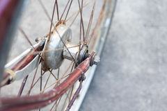 Detail of a Vintage Bike wheel with background texture Royalty Free Stock Photo